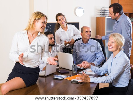 Positive european colleagues discussing price development at office - stock photo