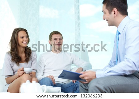 Positive family meeting with a consultant to discuss financial matters - stock photo