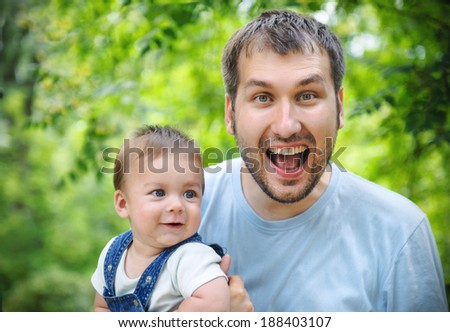 Positive father and his son - stock photo
