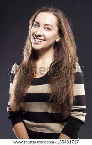 positive female. dark studio background - stock photo