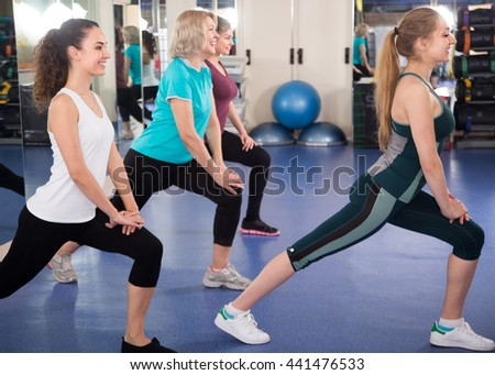 Positive females having gymnastic class in fitness club  - stock photo