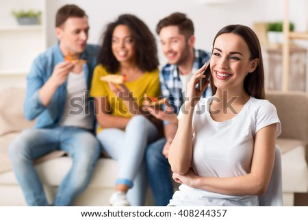 Positive girl talking on mobile phone  - stock photo