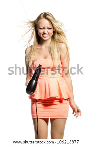 positive girl with hairdryer laughs - stock photo