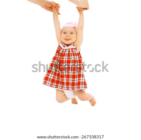 Positive little child hanging on mom's hands and having fun - stock photo