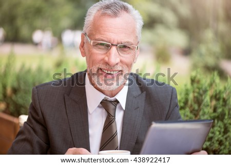 Positive man drinking coffee - stock photo