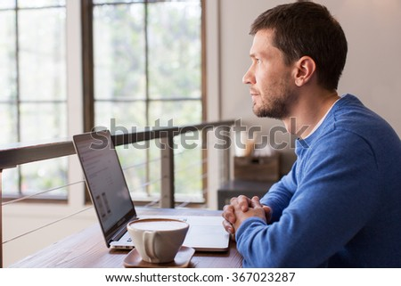 positive man working on laptop computer in cafe drinking coffee, lifestyle concept - stock photo