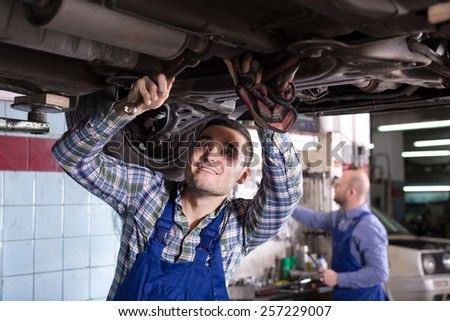 Positive mechanics fixing car  - stock photo