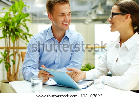 Positive office workers choosing the best business solution - stock photo