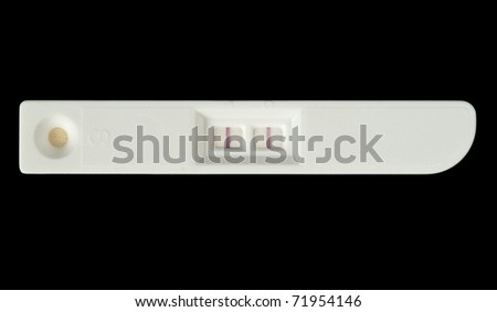 Positive pregnancy test isolated on black - stock photo