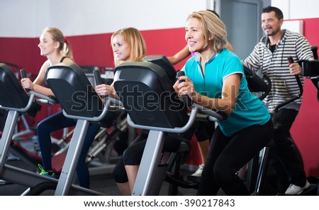 positive russian adults in gym working out at group class - stock photo