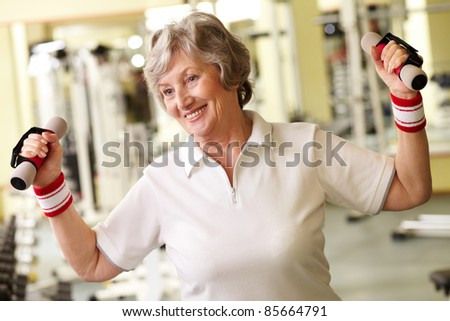 Positive senior woman living active life - stock photo