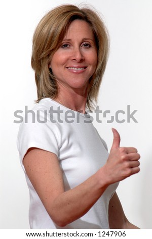 positive sign from pretty woman focus on face - stock photo
