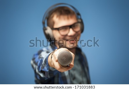 Positive singer or mc sharing microphone - stock photo