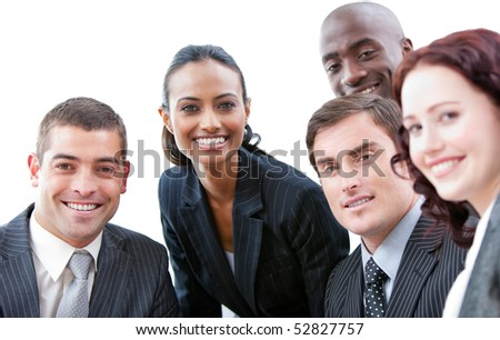 Positive team looking at the camera - stock photo