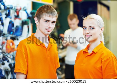 Positive team of sellers or shop assistant group portrait  in supermarket store - stock photo