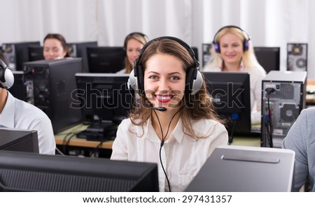 Positive technical support team working at call center office. Selective focus   - stock photo