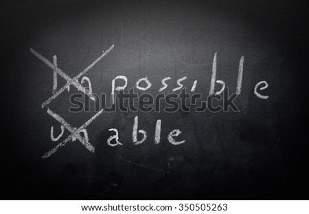 positive thinking concept handwritten on black chalkboard with modified impossible unable word - stock photo
