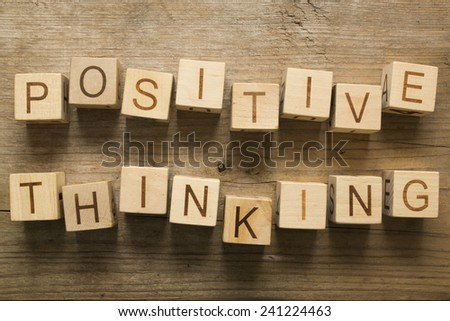 Positive thinking text on a wooden blocks on a wooden background - stock photo