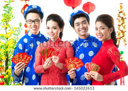 Positive Vietnamese congratulating with Tet �¢?? the traditional celebration of New Year isolated on white - stock photo
