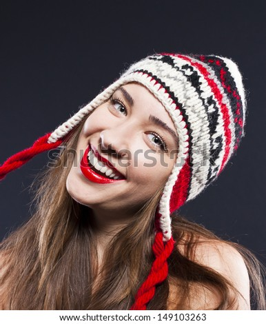 positive woman in hat. Christmas theme - stock photo