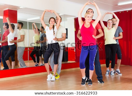Positive young people dancing Latino dance - stock photo