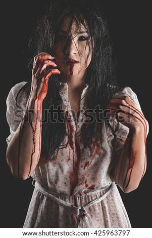 Possessed Woman with bloody body - stock photo