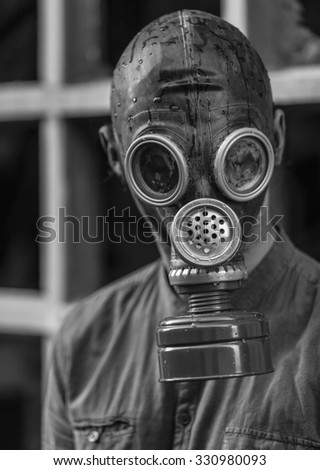 Post Apocalyptic Survivor in Gas Mask. - stock photo