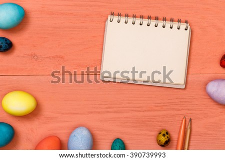 Post blog social media Easter. View from above with copy space. Banner template layout mockup for happy Easter. Pink wooden table, top view on workplace. Colored eggs at the office Desk. - stock photo