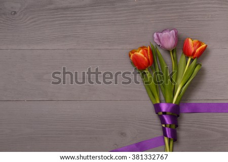 Post blog social media 8 march. View from above with copy space. Banner template layout mockup for woman day. Gray wooden table with tulips. festive bouquet for greeting card with place for text - stock photo