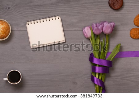 Post blog social media 8 march. View from above with copy space. Banner template layout mockup for woman day. Gray wooden table, top view on workplace. Lilac tulips at the Desk. - stock photo