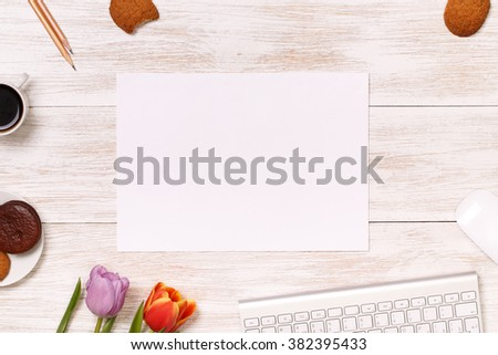 Post blog social media 8 march. View from above with copy space. Banner template layout mockup for woman day. White wooden table, top view on workplace. Lilac tulips at the Desk. Greeting Cards. - stock photo