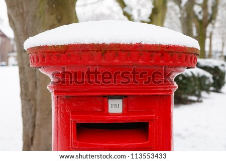 Post box with snow - stock photo