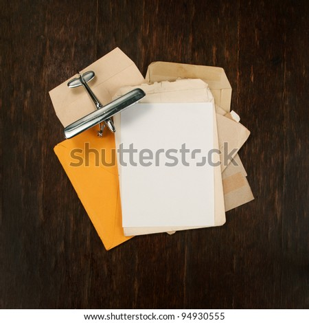 post cover and envelopes with model airplane as background square - stock photo