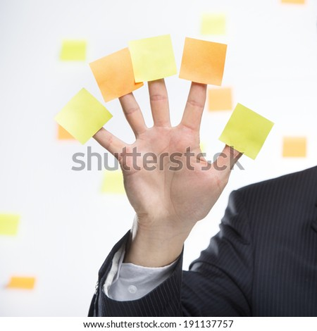 Post Five. Business man with blank notes, just add your messages. - stock photo