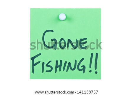 Post it note on wood in green with gone fishing - stock photo