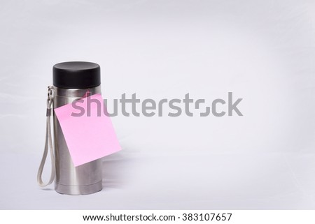 post-it note stuck on a stainless bottle,Empty paper sheet on  stainless bottle - stock photo