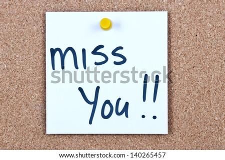 Post it note white with miss you message on cork - stock photo