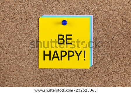 """Post-it notes with word """"Be happy!"""" on cork board (bulletin board). - stock photo"""