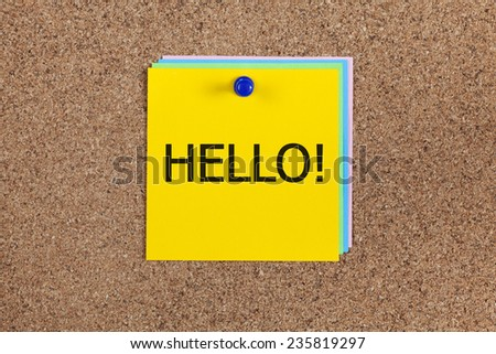 """Post-it notes with word """"Hello!"""" on cork board (bulletin board). - stock photo"""