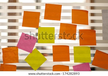 post it reminders stick in office - stock photo