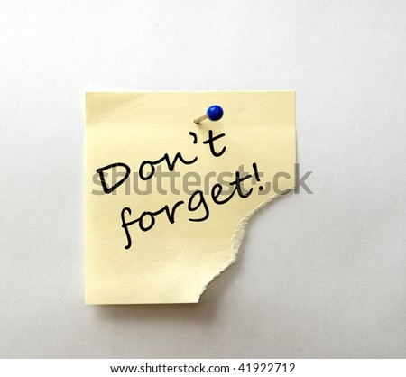 Post-it with message: Don't forget - stock photo