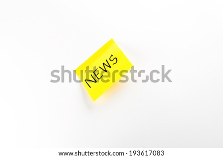 post it write news word on a white background - stock photo