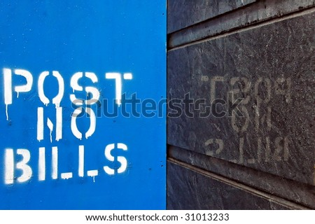 POST NO BILLS - block letters reflected on granite wall - stock photo