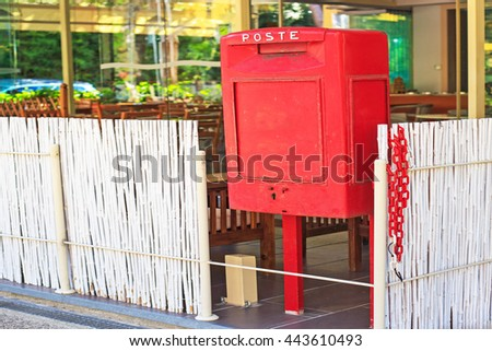 POST  word in Italian on vintage red metal post box at the entrance to the cafe, Milano Marittima, Italy - stock photo