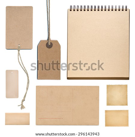 postage stamp, notebook, tag and postcard isolated on white  - stock photo