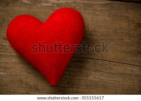 Postcard for Valentine's day, Textile heart on wood desk - stock photo
