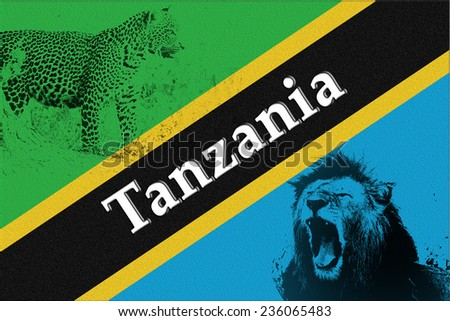 Postcard from Tanzania: flag with silhouette of roaring lion and leopard - stock photo