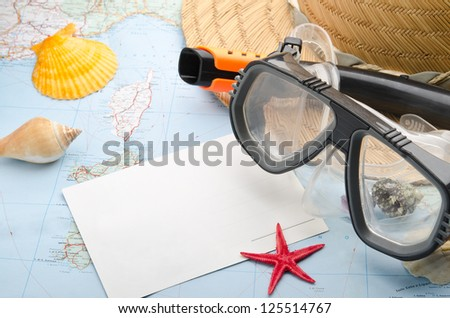 Postcard, mask and snorkel diving on the map - stock photo