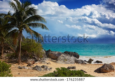 postcard of a beachfront in Tulum, Mexico. Not far of an ancient Mayan fertility temple.  - stock photo