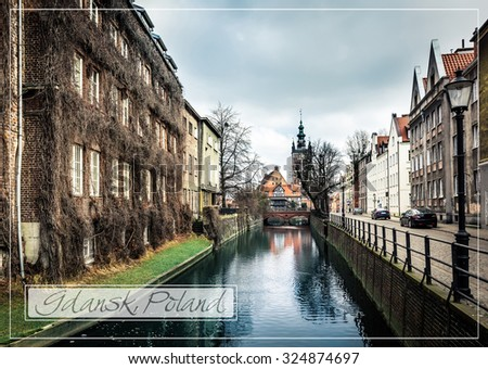 postcard with canal and old historic buildings in the old town of Gdansk, Poland - stock photo